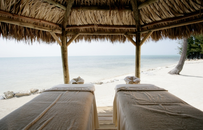 Massage tables at tropical beach.